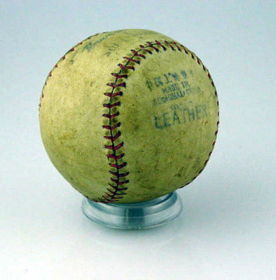 Leather softball, stamped 'Universal'