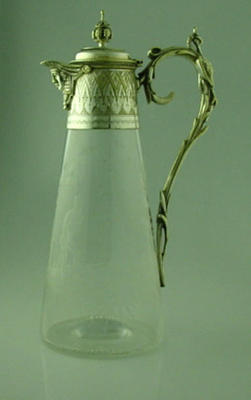 Engraved glass claret jug with silver spout and handle