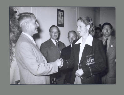 Photograph of Shirley Strickland at a social event, c1955