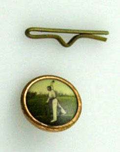 Button and keeper, part of a set of 6, image of cricketer preparing to bowl