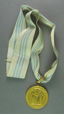 Gold medal won by Shirley Strickland for 80m hurdles race, 1955 International Friendly Sports Meeting of Youth