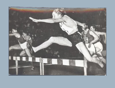 Photograph of Shirley Strickland during 80m hurdles race, 1955 International Friendly Sports Meeting of Youth