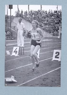 Photograph of Shirley Strickland warming up prior to 100m race, International Friendly Sports Meeting of Youth 1955