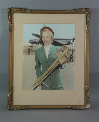 Hand-tinted photograph of Shirley Strickland returning from Poland, 1955