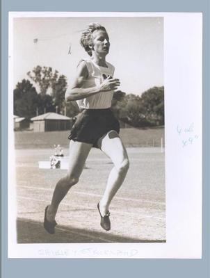 Photograph of Shirley Strickland completing a running race, c1956