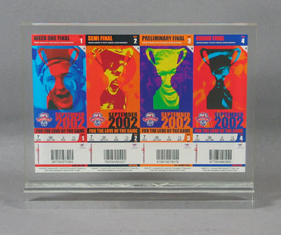 Sample tickets for AFL Finals Series 2002, mounted inside acrylic stand