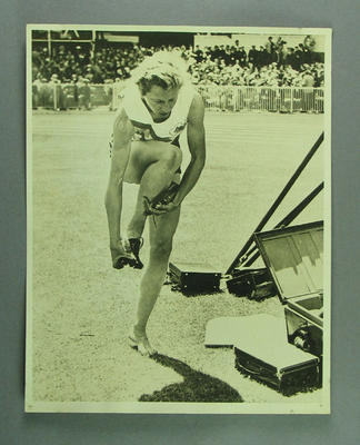 Photograph of Shirley Strickland after 80m hurdles heat, 1956 Olympic Games