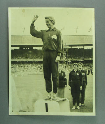 Photograph of Shirley Strickland on podium for 80m hurdles, 1956 Olympic Games