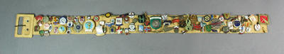 Assortment of Olympic badges collected by Shirley Strickland, affixed to a belt
