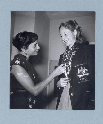Photograph of Shirley Strickland in blazer with badge collection, Warsaw 1955