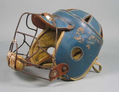 Blue leather lacrosse helmet worn by 'Skip' Horst,  USA Washington-Virginia Lacrosse team, visiting Australia 1959