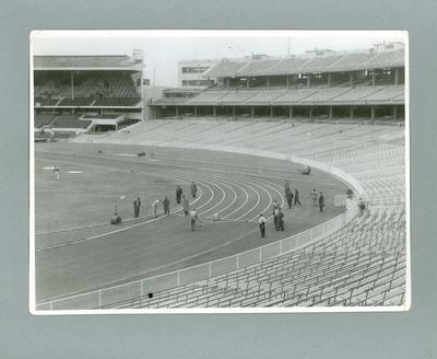 Marking the lanes on the running track at the MCG, 1956 Olympic Games