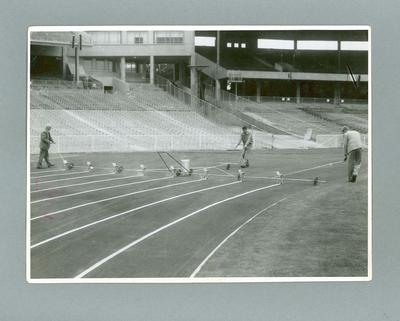 Photograph, marking the lanes on the running track at the MCG - 1956 Olympic Games; Photography; 2004.4123.6