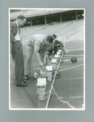 Preparing to mark the lanes on the running track at the MCG, 1956 Olympic Games; Photography; 2004.4123.7