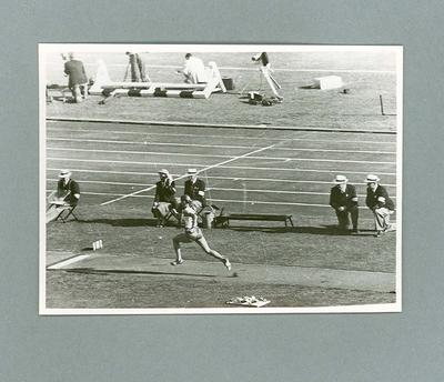 Male athlete in run-up to long jump event at MCG, 1956 Olympic Games