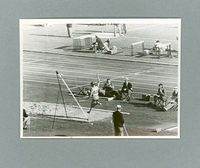 Male athlete competing in  long jump event at MCG, 1956 Olympic Games