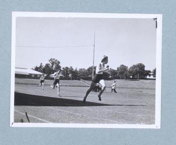 Photograph of Shirley Strickland during a running race, c1947-60