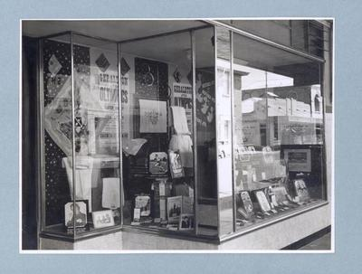 Photograph of shopfront with Shirley Strickland trophy & medal display, c1947-60