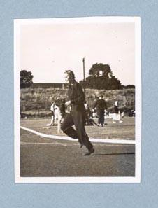 Photograph of Shirley Strickland running in tracksuit, c1947-60