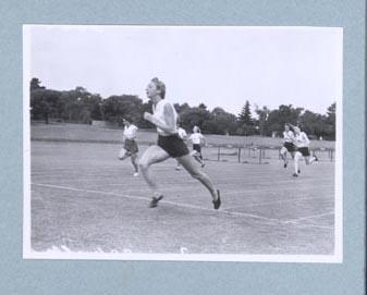 Photograph of Shirley Strickland winning a running race, c1947-60