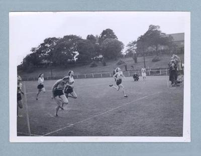 Photograph of Shirley Strickland finishing a running race, c1947-60; Photography; 2003.3903.1487