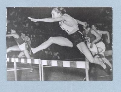 Photograph of Shirley Strickland during a hurdling race, Warsaw 1955