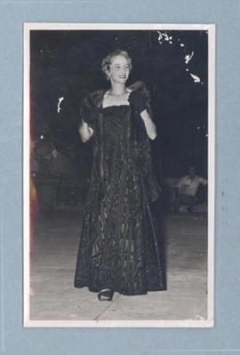 Photograph of Shirley Strickland modelling a long dark gown, c1947-60