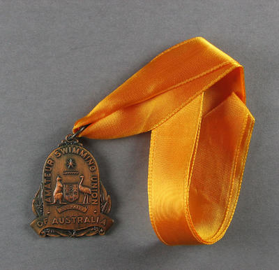 Bronze medal on ribbon, Synchronised Swimming, 1969 Swimming Championships.