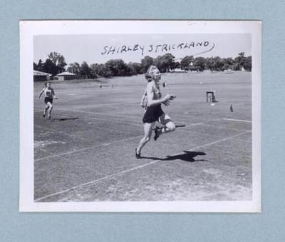 Photograph of Shirley Strickland finishing a running race, c1947-60