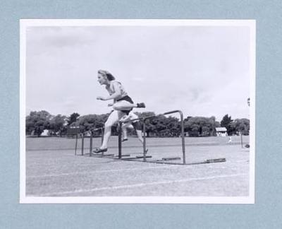 Photograph of Shirley Strickland during a hurdles race, c1947-60