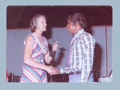 Photograph of Shirley Strickland presenting a sportsman of the month award, Kalgoorlie 1975