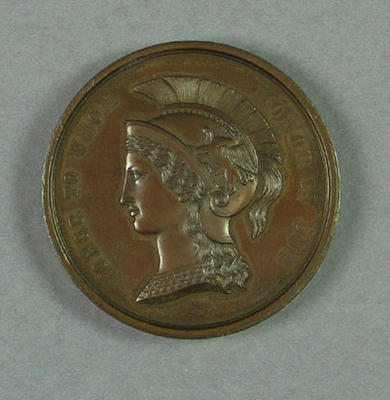 Medal won by R C Esler, first place in under 14 fifty yards race - 1919