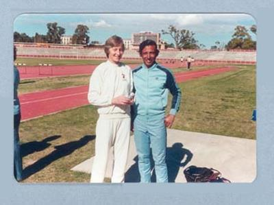 Photograph of Shirley Strickland with an athlete, undated