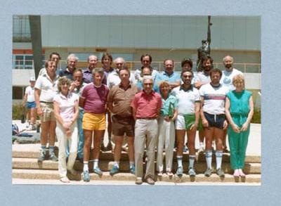 Photograph of Shirley Strickland with group, Canberra Coaching Conference 1985