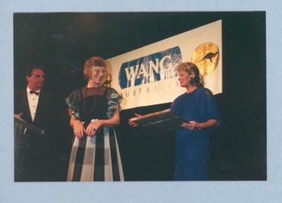 Photograph of Shirley Strickland being presented with an award, c1988