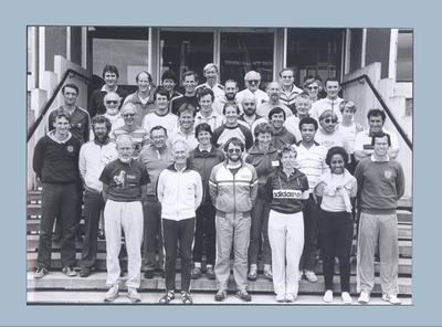 Photograph of Shirley Strickland with group at New Zealand coaching conference, undated
