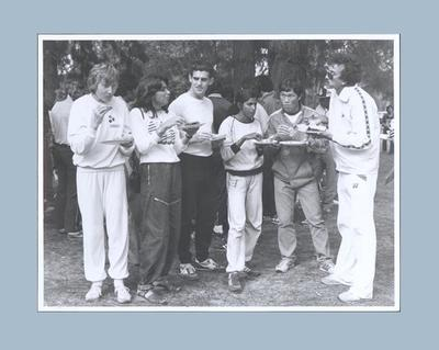 Photograph depicting group of athletes eating, undated