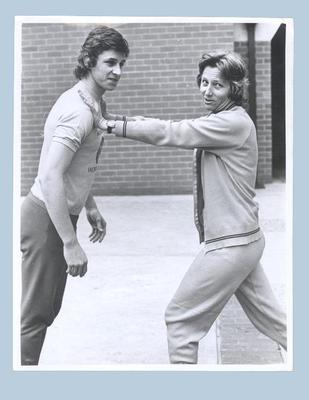 Photograph of Shirley Strickland demonstrating training techniques, undated
