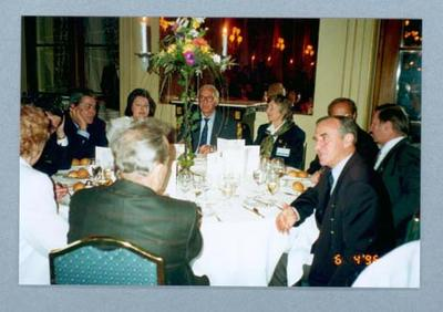 Photograph of Shirley Strickland seated at a table for a meal with group, April 1996