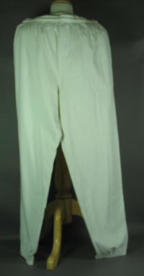 White pants worn by Shirley Strickland whilst carrying Olympic flag, Sydney 2000