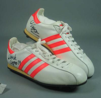 Pair of autographed white leather football boots made for Warwick Capper, c1987