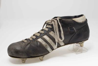 Football boot, worn by Russell Ebert c1970s