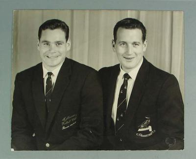 Studio photograph of Ron Barassi and Murray Weideman in Melbourne Football Club blazers & ties, c1963