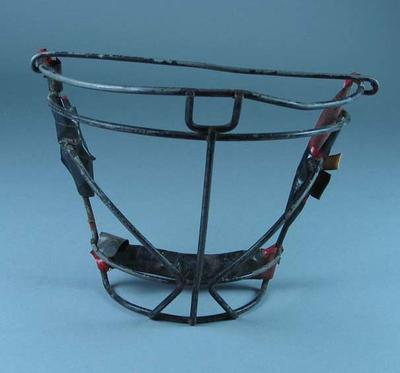 Wire face guard worn with padded cloth cap during 1960-1970s experimental period between cloth helmets and plastic helmets - Lacrosse