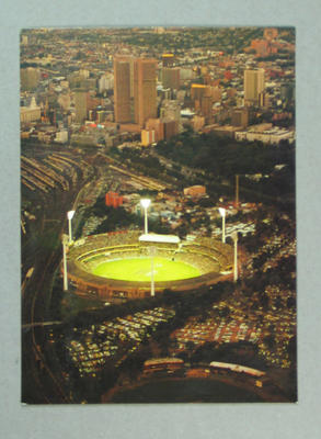 Postcard, image of Melbourne Cricket Ground at dusk; Documents and books; M14000