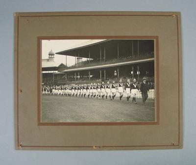 Photograph - Victorian State Football team marching around a ground c.1930; Photography; 1989.2114.12