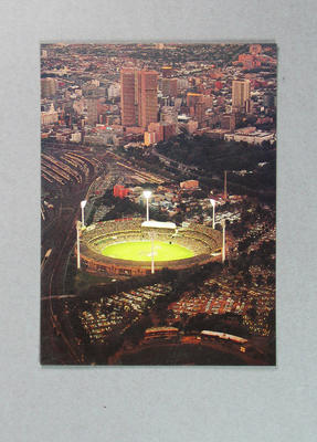 Postcard, image of Melbourne Cricket Ground at dusk; Documents and books; M14005