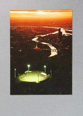 Postcard, image of Melbourne Cricket Ground at dusk with Yarra River in background
