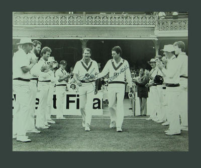 Photograph of Greg Chappell & Dennis Lillee entering field of play for the final time, SCG - 1984