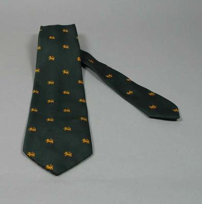 Tie, dark green featuring small gold lion emblems